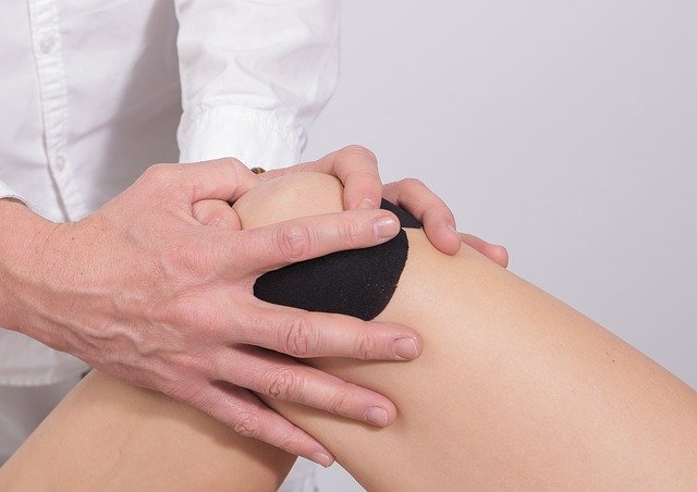 person getting their knee checked